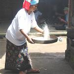 Woman preparing rice for a wedding feast in Bali.