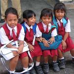 Little girls greet me as I enter an elementary school in Bali.