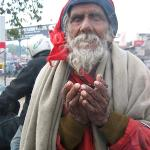 A blind man begs for money in New Delhi