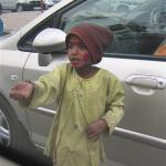 Every time our car stopped at a street light in India a beggar came to the window