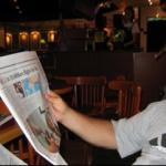 Reading the morning paper at Pacific Coffee