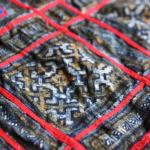 Tinted indigo batik on cotton. Note that some areas of the batik have been selectively tinted with a warm brown natural dye to give added dimension to the design.