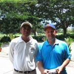My husband with his golf caddy in Kota Kinabula