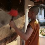 Novice Monk Banging Temple Drums