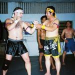 Antonio Graceffo (left) learns the Khmer martial art of Bokator under the watchful eyes of Master San Kim Saen in Phnom Penh.