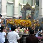 Devotees pay homage to Phra Phrom at Erawan Shrine