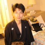 Me in hotel room putting on kimono
