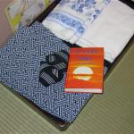 Neatly folded kimonos and the Buddhist Scriptures were provided in our ryokan