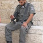 Armed guard asleep at the Wailing Wall