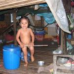 A child in her lean to home on Lake Tonle Sap