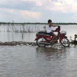 A motorcycle driver on Lake Tonle Sap