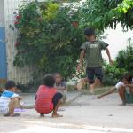 Children play on the grounds home to Partners In Compassion.