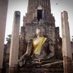 Buddha image in front of Wat Phra Prang at historical park