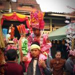 Sang Long is carried around before enter the temple
