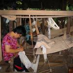 People weaving cotton