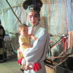 Backstage with a Chinese opera troupe in Penang, Malaysia    This baby's bed is a backstage bassinet, and he has already heard more Chinese operas in his short lifetime than most of us ever will.