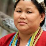 A Aka Tribal woman of West Kameng district of Arunachal Pradesh wearing a traditional headgear made of Silver
