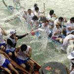 There was an air of camaraderie at the dragon boat festival in the Sai Kung district of Hong Kong, 25 June 2001 when competitors ended off their race by splashing water on each other with their paddles. The event, also known as Tuen Ng Festival, dates back 2000 years and is held on the fifth day of the fifth lunar month. Hong Kong celebrates this public holiday in a big way, with races all over the city and new territories.