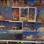 Postcards of the Boudhnath stupa on sale on the kora around the sacred monument, Kathmandu
