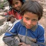 A brother and sister on their way to school in Kermi (9,150'), Nepal.