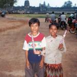 A brother and sister take a break from their sales duties and pose in front of the famous Angkor Wat temple.