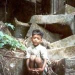 A young boy rests on some of the ruins at Beng Mealea, Siem Reap, Cambodia.