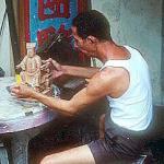 Wood carver at work.