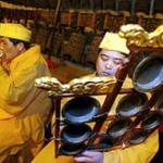 Chinese musicians perform at the Bell temple in Beijing, China, welcoming the New Year.