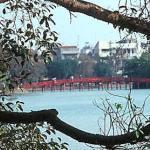 Thê Huc ('Rising Sun') Bridge leads to Ngoc Son Temple in Lake Hoan Kiem, Hanoi, Vietnam.