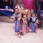 Some Hmong children dressed in their traditional to pose with tourists. Each pose costs 20 Baht.