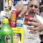 A Pakistani shop-owner arranges Indian cosmetics at his shop in the 'Indian bazaar' in the eastern Pakistani city of Lahore.