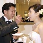 Yuichi Nakasho feeding a piece of cake to his bride, Yuko Sasakawa, during their wedding reception at a wedding hall in Tokyo.
