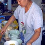 Tim from Lamduan Faham Kao Soi shop serving up Chiang Mai?s famous noodle soup.