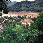 Luang Prabang, former capital of the Lao monarchy, basks beside the Mekong, seemingly secure in its bowl of mountains.