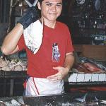 It's nice and fresh, promises the young fishmonger. And he's probably right. The fish at the market comes straight from the fishing harbour at Phuket Town.