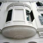 The Metropole's trademark white facade with green shutters