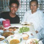 Dee and his grandmother in front of the dinner feast. Phnom Penh, Cambodia.