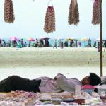 A vendor enjoys a nap on a beach in Cox's Bazar resort, 06 December 2002. Bangladesh's fledgling but troubled tourism industry is slowly luring foreign and domestic travellers with one of the most popular destinations this winter being this beach resort town of Cox's Bazar on the Bay of Bengal, which drew sun-worshippers from as far away as Europe and Southeast Asia.