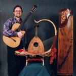 Musicologist Rick Heizman with some of his favorite musical instruments: In the center is a Burmese saung gauk, behind it is a Middle Eastern oud from Syria, on the right is a Chinese zheng.