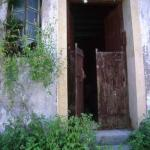 Door of abandoned home in ghost village, Sai Kung, Hong Kong.