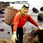 Kotoyo Motohashi, 68, Japan's legendary 'Ama' woman shellfish diver, smiles at a sea shore in Shirahama city, 100km southeast of Tokyo. Motohashi has been diving without tanks since the age of 18.