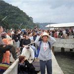 Suratthani, Thailand. Suratthani is the coastal town from which ferries to the Samui archipelago embark. A tourist horde looks on as a ferry tries to dock, or, having docked, unloads its cargo.