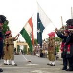 Pakistani paramilitary troopers with their Indian counterparts lower down their respective national flags at the Joint Check Post (JCP) at the Wagah border crossing between Pakistan and India.