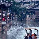 Wuzhen, Zhejiang, China. Visitors take a cruise on the Beijing-Hangzhou Grand Canal, thru Wuzhen.