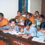 Novice monks and village kids in a Banan English class.