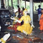 Phimai, Thailand: Both monks and laymen construct the wax sculptures, which consist of a base of wood or plaster coated in beeswax of various hues, e.g. saffron and green. Multi-colored pins are inserted to resemble jewels. Paint is then applied to highlight faces and other features.