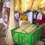 Bundles of dried banana bark (hanging left) and bamboo leaves.