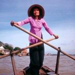 A woman in Can Tho rows across the Can Tho River which flows into the Hau Giang or Lower River, one of two main branches of the Mekong that run through Vietnam after the river splits in Cambodia. Can Tho is considered the political, economic, transportation and cultural center of the Mekong Delta.
