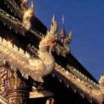 Mythological serpents decorate Thai temple roofs