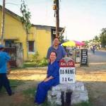 Taking a break from the long drive. A French road marker (found all along Highway One) alongside the road to Danang.